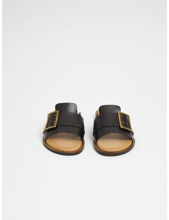 Black sandal buckle.