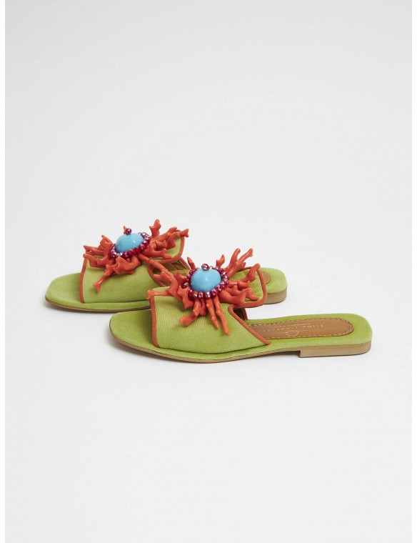 Green sandal with corals.