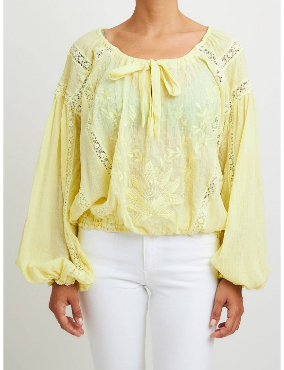 Long-sleeved blouse with bow.