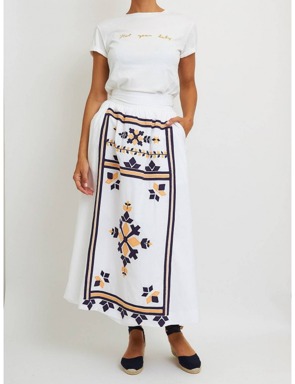 White skirt embroidery.